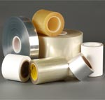 Slit custom tapes and adhesives on rolls